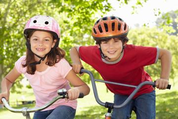 Boy and girl riding bikes