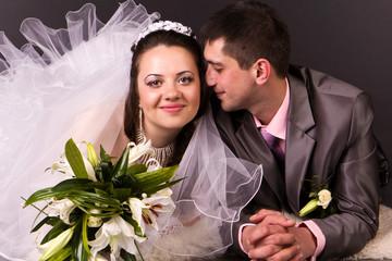 Happy bride and groom lying