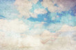 Grungy background with white clouds