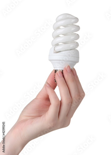 Arm holding energy saving lamp isolated on white