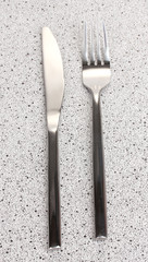 Fork and knife on marble table