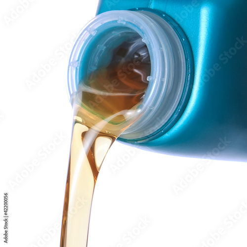 Pouring motor oil. Closeup.