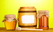 Sweet honey in jars and barrel with drizzler