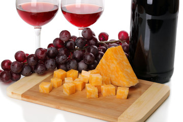 Bottle of great wine with wineglasses and cheese isolated