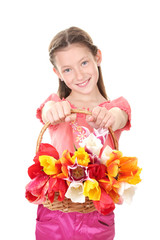 Portrait of beautiful little girl with tulips in basket