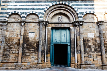 Ornate White and Black Church in Volterra, Tuscany, Italy