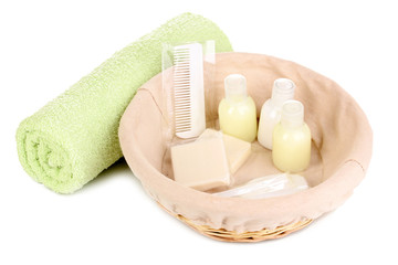 Hotel amenities kit in basket isolated on white
