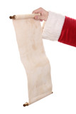 Santa Claus hand holding list on white