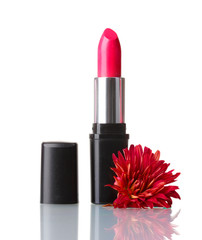New lipstick and flower on the white background
