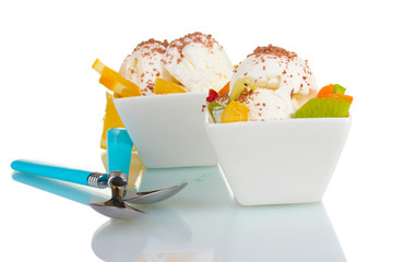 delicious vanilla ice cream with chocolate and fruits in bowls
