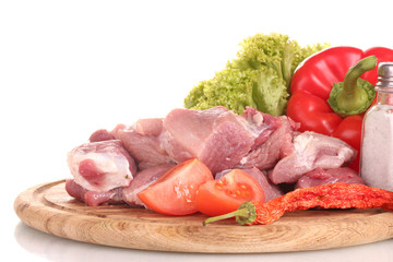 Pieces of raw meat and vegetables