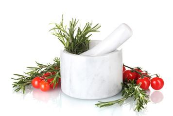 fresh green rosemary in mortar and tomatoes cherry isolated