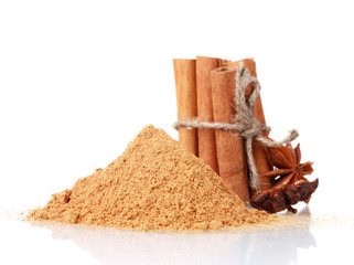 Cinnamon sticks, powder and anise isolated on white