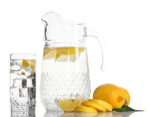 pitcher and glass of lemonade and lemon isolated on white