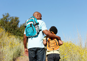 Father and son on country hike