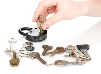 Selecting key to padlock isolated on white