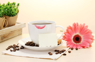 cup of coffee with lipstick mark and gerbera beans, cinnamon