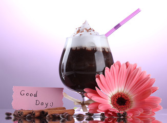 glass of coffee cocktail and gerbera flower on purple