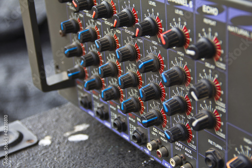 Part of an audio sound mixer with buttons