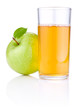 Glass of apple juice, green apples with leaves and drops of wate