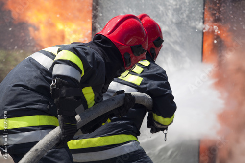 firefighters in action - 42224219