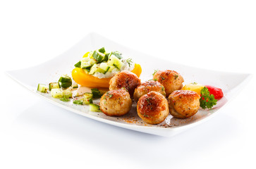 Roasted meatballs and vegetable salad