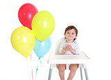 Baby celebrating with balloons