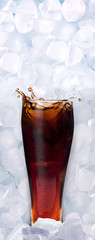 fresh cool glass of cola in ice cube
