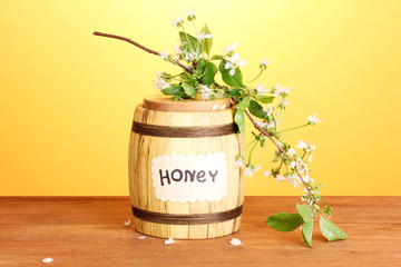 Sweet honey in barrel with blossoming branch