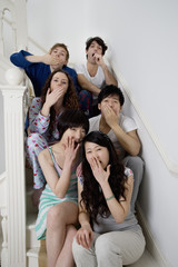 Group portrait of young friends yawning