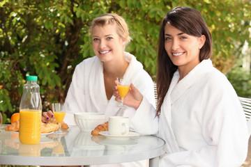 Women having breakfast outside