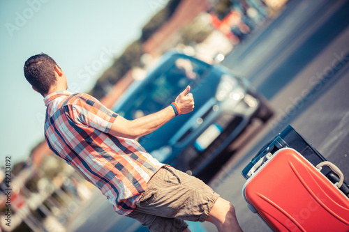 Young Man Hitchhiking