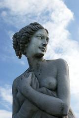 Female antique gardening sculpture