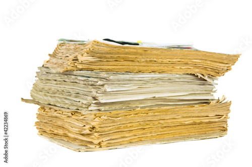 stack of old newspapers isolated