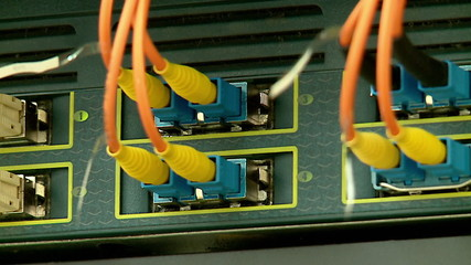 communication cables and flashing LEDs in the server rack