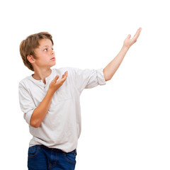 Young Boy pointing with hands at copy space.