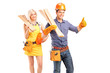 A smiling carpenter team of man and woman holding sills