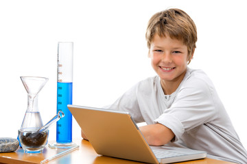 Young student with laboratory equipment.