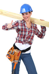 Female carpenter with wood