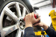 Detail car mechanic changing tyre