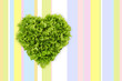 lettuce in the shape of heart on colored tablecloth