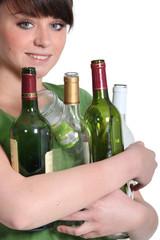 Girl carrying glass bottles