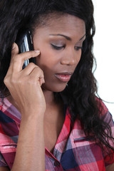 a black woman at phone