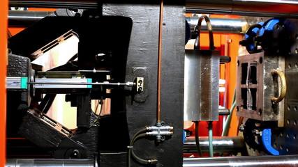 pan on plastic press molding machine during work