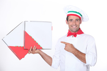 Chef pointing at pizza boxes