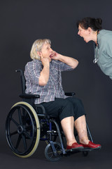 Elder abuse senior woman being shouted at by nurse