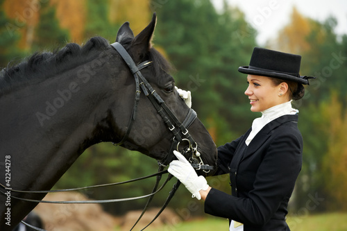 horsewoman jockey in uniform with horse - 42244278
