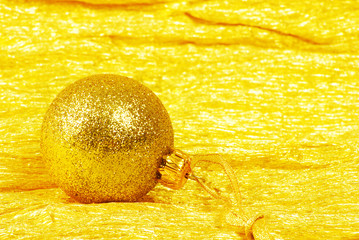 Christmas ball on golden background