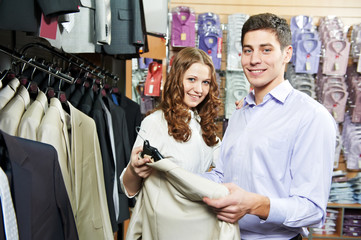 Young peoples shopping at clothes store