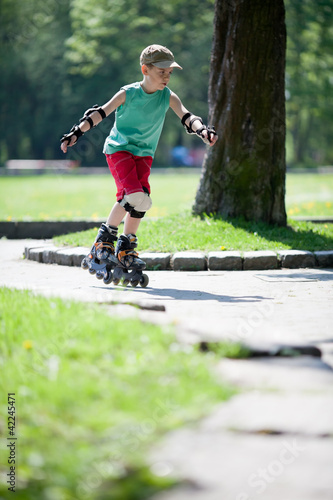 Little boy on rollerblades